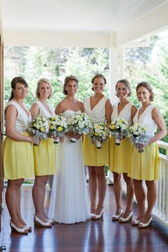 Bride and her bridesmaids - yellow and white wedding colors.