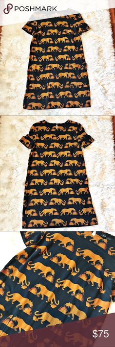MARC JACOBS Lioness Dress Extra small (XS) Shift Dress from Marc by Marc Jacobs. Stunning lioness print. Very rare and is sure to impress anywhere you wear it! Two pockets on front; keyhole closure with button on back. Marc by Marc Jacobs Dresses Midi