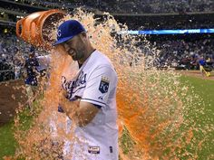 Kansas City Royals' Mike Moustakas (8) gets the celebration Gatorade dunking from Salvador Perez after the teams 7-4 win over the Boston Red Sox during Saturday's baseball game on June 20, 2015 at Kauffman Stadium in Kansas City, Mo.