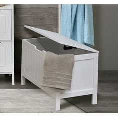 This Storage Chest Cap Ferret is made of white painted sturdy wood - medium-density fiberboard (MDF) and features a large top cover with an opening up to 22.44 Inch to ease any storage. It's an elegant way to fit more necessities into your bathroom, closet, bedroom or playroom and to provide ample storage. This elegantly-designed storage chest is easy to assemble with the included hardware and features a safety lid support, the soft close system enables any lid position and will never dro...