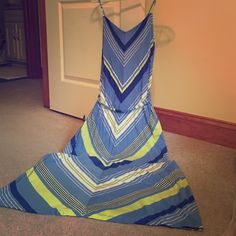 Old Navy chevron sundress with bright fun colors! This size large Old Navy sundress features a built-in shelf bra, adjustable straps, and a gorgeous chevron pattern in shades of blue white and lime green - perfect for summer! Truly adorable, no longer fits. Worn only a few times, great condition! Old Navy Dresses Maxi