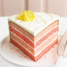 Pink Lemonade Cake  1 cup butter  4 eggs  3 1/3 cups all-purpose flour  1 TBS baking powder  1/2 tsp salt  2 cups sugar  Red food coloring  1 1/3 cups milk  1/4 cup frozen lemonade concentrate, thawed  1 tsp pure lemon extract  1 recipe Lemonade Butter Frosting