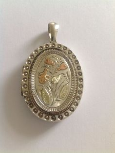 Fine Victorian Sterling Silver & Bi Colored Gold Decorated Oval Hinged Locket