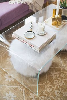 Clear coffee tables in lucite, acrylic, plastic and glass open up small living rooms and spaces. Find more decorating ideas, room ideas, home interiors, furniture, accessories, paint colors and prints on Domino.