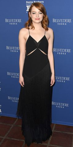 For the Santa Barbara International Film Festival, Emma Stone opted to stun in a not-your-average black dress: a slinky Stella McCartney slip with sliced ribcage-exposing cut-outs and tiers of fringe.