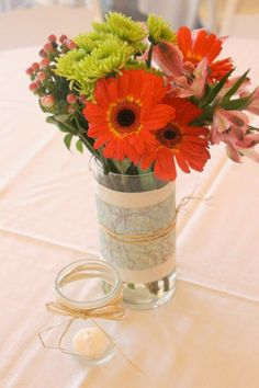 """Traveling From Miss to Mrs"" Bridal Shower Theme: Maps on vases for centerpieces"