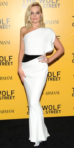 MARGOT ROBBIE At The Wolf of Wall Street premiere, Margot Robbie stole the spotlight in a white one-shoulder Armani Prive gown with a sequined black panel at the waist. Spider pearl earrings and a diamond armor ring both by Jacob & Co. completed her look.