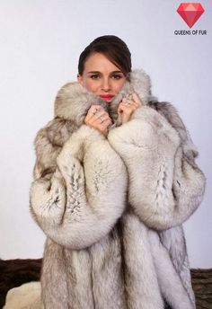 Natalie Portman in a blue fox fur coat