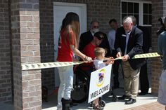 CPL Isaac Jensen being presented with his new home thanks to Homes For Our Troops