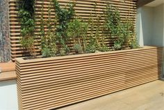 LOVE THIS!! modern patio planter box - under deck wall idea.