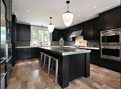 Dark cabinets, grey countertops and light wood floors.like the floor color with dark cabinets. Would go with lighter countertop though. Luxury Kitchen Design, Luxury Kitchens, Espresso Kitchen, Grey Countertops, Black Kitchen Cabinets, Home Kitchens, Kitchen Renovation, Dark Kitchen Cabinets, Contemporary Kitchen