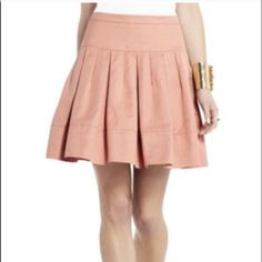 price firm❗️BCBGMAXAZRIA pleated skirt peach/blush color pleated skirt with pockets. sits between hips and waist. like new, no stains rips holes pulls pills or tares. NO TRADES. REMOVING FOR CONSIGNMENT IF NOT SOLD 3/10 BCBGMaxAzria Skirts A-Line or Full