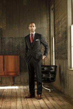 J. Hilburn three-piece black suit.