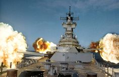 """USS New Jersey (BB-62) fires her main 16"""" 50 caliber and 5"""" 38 caliber secondary guns, in the northern Pacific Ocean."""