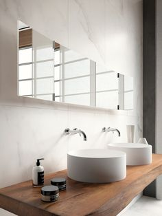 round white bathroom sink on wooden plank