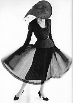 Model in a chiffon dress with detachable overskirt by Jacques Fath, 1952 Unidentified photographer