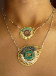 Al Embroidered Necklace $30.00.  I want to make my own. Basically take a pendant and embroider a design on it.  Cool idea.