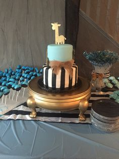 Baby shower cake. Black and white stripes with gold safari