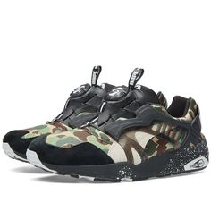 A BATHING APE® has teamed up with athletic label Puma to debut a collection that includes performance sports apparel and footwear, fused together to blend high-street style and sports. From the A BATHING APE x Puma collaboration, the Puma Disc Blaze combines the best of the early 90's sneaker innovation with new contemporary aesthetics. Constructed with premium leather and camo textile uppers, the sneaker sits on a Trinomic midsole with the iconic Disc Blaze lock system.  Leather Uppers…