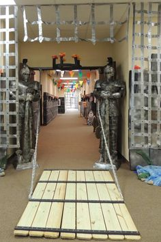 Foil portcullis and wooden drawbridge entrance for medieval party. Game of Thrones-esque!