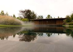 Artificial mist envelops this wooden meditation pavilion near Geneva