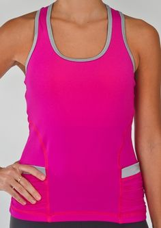 """Fitted  Two tone color combination  Scoop neck  Razorback  Ruched styleside pockets   Elasticized armhole  Internal 360 bra w/removable padded support  """"StayDry"""" Wicking Microfiber Material  UV Protection UPF 50 - Blocks 98% of sun's UV rays  Anti-Bacterial Treatment       $54.00      Product Code: 21179"""