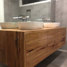 Double vanity made from wormy chestnut timber with push to open drawers