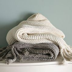 Get knit. The perfect antidote to a cold evening, the hand-knit Chunky Tassel Throw keeps you warm with its huggable texture, and cozies up ...
