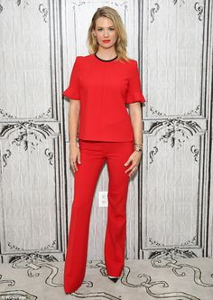 Crimson cutie: The 38-year-old actress showcased her long slender pins in a bright red mat...