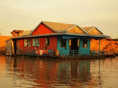 Upon the flood plain of Cambodia's Tonlé Sap Lake (Khmer; great lake) is Kampong Phluk (Khmer; harbour of the tusks), a floating village with rustic and colourful double-storied houses on stilts. Home to nearly 500 families, Kampong Phluk's homes rise to nearly six meters above the ground.