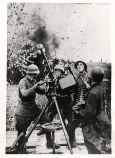 1942- Russian Red Army crew keeps anti-aircraft machine gun trained on German planes that are attempting to attack Soviet battery.