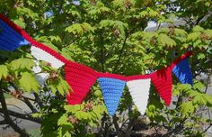Pennant Bunting (free pattern)  A fun decoration for holidays.  Imagine in pastels for Easter or a baby shower.  In school colors for graduation or homecoming.  The options are as endless as your imagination.