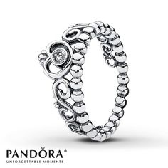A clear cubic zirconia accents a crowned heart set along a band of scrolls and beads in this sterling silver ring from the PANDORA Stories Spring 2013 collection. Additional sizes may be available through special order at your nearest Jared location. Style # 190880CZ-54.