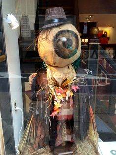 in the garden fall scarecrow window display optometry Halloween Window Display, Halloween Displays, Holidays Halloween, Halloween Fun, Halloween Office, Vintage Halloween, Spooky Decor, Halloween Decorations, Fall Scarecrows