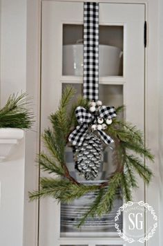 CHRISTMAS FARMHOUSE KITCHEN: so many gorgeous details! Pine wreaths with beautiful ribbon hanging from cabinets