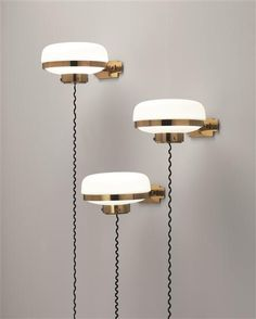 Funny to have those wires just hanging down like that. GINO SARFATTI, Set of three wall lights, model no. 240