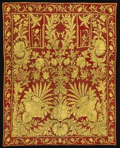 AN OTTOMAN RED-GROUND SADDLE-COVER, TURKEY, MID-19TH CENTURY of rectangular form, with a red velvet ground decorated with yellow and silver gilt threads with embroidered and appliqué work, featuring palmettes and floral designs with leafy fronds and sequins throughout, the border with a meandering vine with tulip stems, dark purple silk lining to reverse