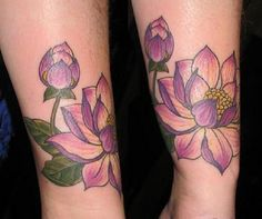 Purple lotus flower tattoo with a bud. The flowers are seen to be in different phases of their lives as one is fully bloomed and the other has not opened up yet to bloom.