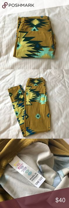 BNWT - LuLaRoe Aztec Leggings - OS Brand New! Stunning LuLaRoe olive/mustard leggings with blue, yellow, turquoise, and dark teal Aztec print. Size OS. Purchased in a mystery bag promotion and I already have this print. I LOVE them! These have never been tried on and only taken out of packaging to photograph. Comes from a smoke free home. LuLaRoe Pants Leggings