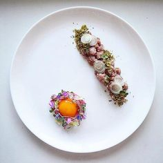 Chef Berliner Speisemeisterei Canadian chef It's veal tartare organic veal, marinated cucumber, marinated onions , microgreens and wild flowers