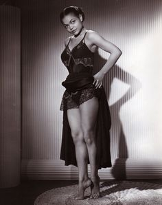 Eartha backstage at the Blue Angel, New York. Those gams!