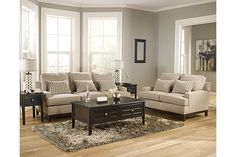 """The Donella Sofa from Ashley Furniture HomeStore (AFHS.com). With the exciting look of the sleek set-back track style arms along with the rich finished woodtrim accent base, the """"Donella-Barley"""" upholstery collection flawlessly captures a modern contemporary flair while offering the comfort of thick boxed back and seating cushions that you can really sink into."""