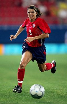 Mia Hamm is arguably the greatest women's soccer player to ever play the game. She made numerous appearances on the national and Olympic teams, and she broke almost every record imaginable. Although her name will probably remain in the record books indefinitely, her records alone cannot describe everything she has done, not only for the sport of soccer but for all women's sports.
