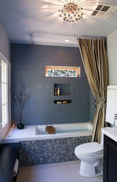 Love the retro feel of this bath! The funky light fixture pulls it all together.