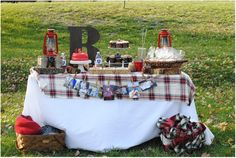 Love the plaid fabric & use of baskets for blankets