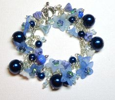 Bracelet Blue Cobalt Swarovski Crystals and White Crystal Pearls Lucite Czech Glass Pearls Glass Silver  FREE SHIPPING. $20.00, via Etsy.