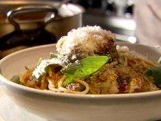 Spaghetti and Meatballs : For the ultimate Italian dinner, Tyler makes large pork and beef meatballs and serves them with a homemade tomato sauce.