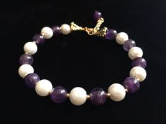 A personal favorite from my Etsy shop https://www.etsy.com/listing/289366475/amethyst-stretch-bracelet-with-faux