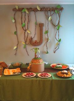 Jungle safari themed baby shower. Large paper mâché letter wrapped in twine. The vines were made from brown postal paper and scrapbook paper.