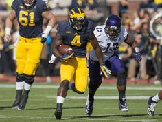 Michigan running back De'Veon Smith runs away from